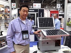 Photo: Hsu with Solar e Power Cube.