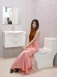 Photo: A model presenting bathroom fixtures.