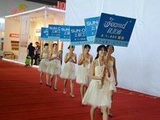 Photo: Exhibitors hire models.
