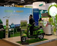 Photo: Hong Kong exhibitor demonstrates application of its new e-scooter