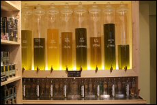 The store features an oil fountain, allowing customers to blend and taste their own olive oil