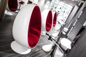 The egg-shaped capsule chairs offer clients privacy during treatment