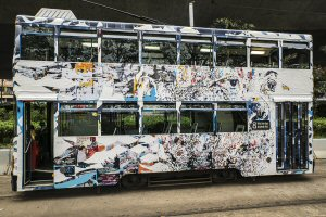 "An ""intervention"" on a Hong Kong tram by street artist Vhils"