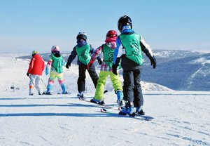 A junior group ski lesson