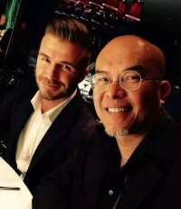 Gabe Shum, owner of Freedom Tattoo Hong Kong, with celebrity client David Beckham