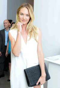 Candice Swanepoel wearing the Jessica clutch from BOTTLETOP