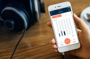 The app enables users to conduct a hearing test to calibrate the device