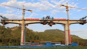 With pandemic precautions in place, work has resumed on the rail‑link project