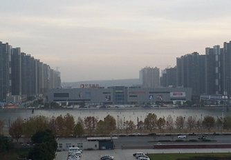 Photo: A residential project under construction and soon-to-open Quanshun shopping plaza