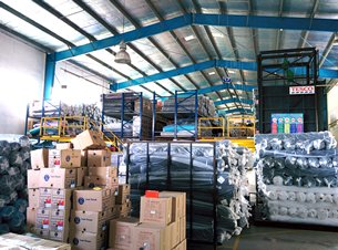 Photo: Warehouse facilities within a local garment factory.