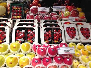 Photo: Imported fruit sold in a supermarket.