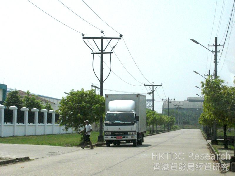 Photo: A paved concrete road inside the Mingaladon Industrial Park