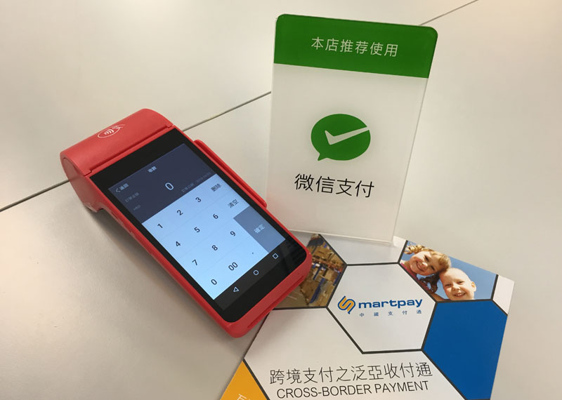 Photo: Besides online payment, retailers may accept mobile payment through a point-of-sale terminal.
