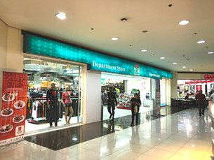 Photo: Department store inside a community shopping mall.