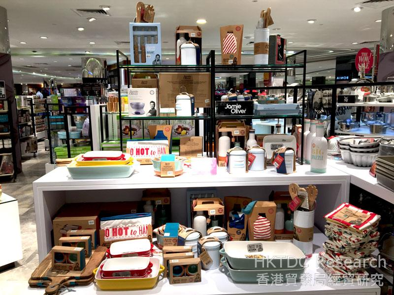 Photo: Stylish cookware and tableware displayed in a department store.