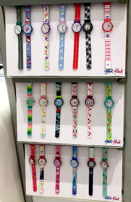 Photo: Flik & Flak watches displayed in a kids' clothing store.