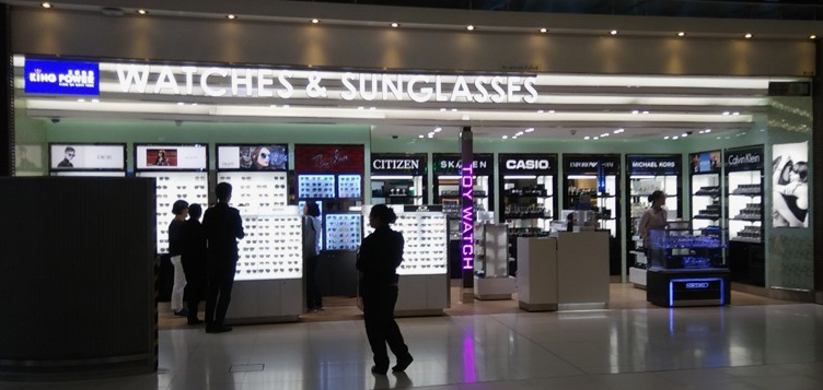 Photo: An airport shop specialises in watches and sunglasses.